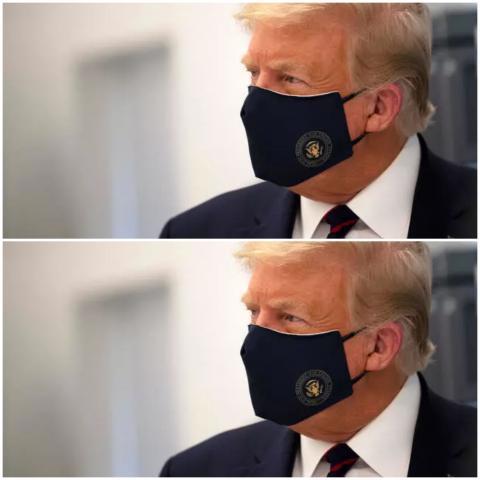 ترامب عند ظهوره العلني الأول بالقناع جيم واتسون اف ب/ارشيف